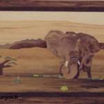 Un éléphant dans la savane à côté d'un baobab