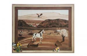 Cette marqueterie représente des chevaux dans la prairie des Vosges avec des pensées qui sortent de l'œuvre